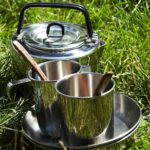 Camping kitchenware in grass