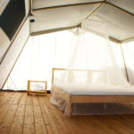inside a large tent with luxurious furnishings